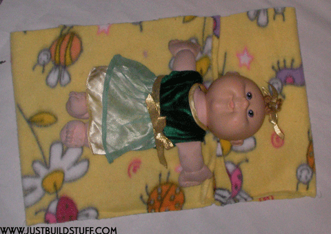 make sure the doll fits on the fabric